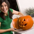 Stock Photo: Joyful Pumpkin Carving