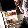 She gets Into Fridge — Stock Photo #12830464