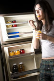 She gets Into the Fridge — Stock Photo