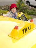 Woman enters a Taxi — Stock Photo