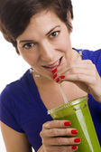 Woman sips Green Smoothie — Stock Photo