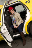 Woman exits a Taxi — Stock Photo