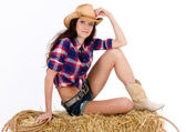 Cowgirl on a Haybale — Stock Photo