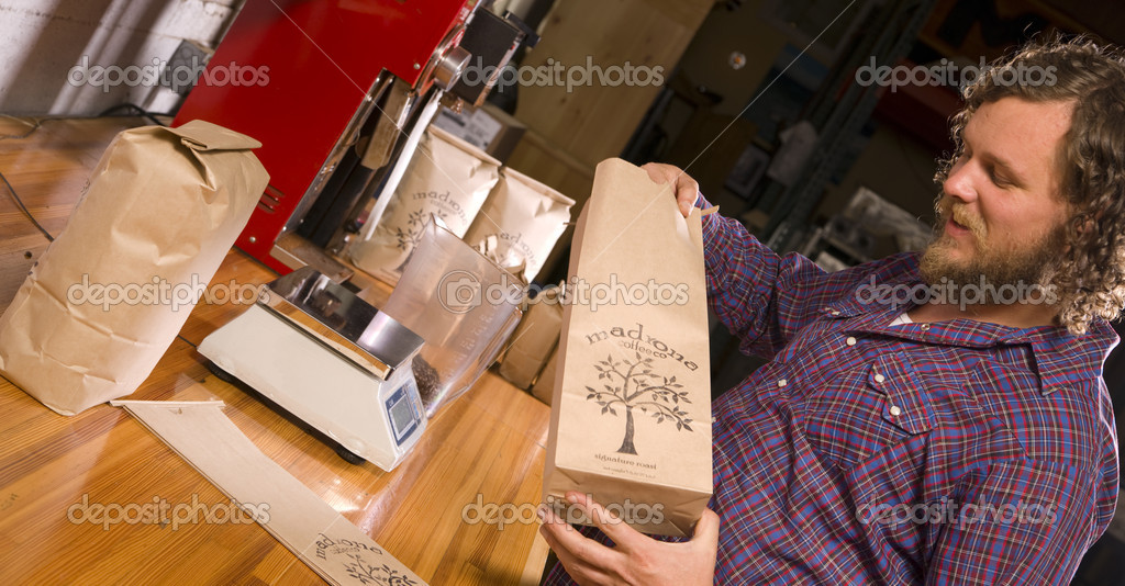 One of the owners of Madrona Coffee bags some product for delivery — Stock Photo #13872989