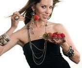 Woman eats RAW fruit — Stock Photo