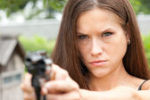 Determined Female Holding Revolver Gun Range Shooting Proctice — Stock Photo
