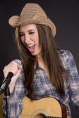 Attractive Cowgirl Singer Enthusiastically Performs Song Microphone Acoustic Guitar — Stock Photo