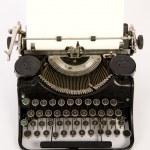 Obsolete Vintage Typewriter Staged on White Background — Stock Photo #14216352