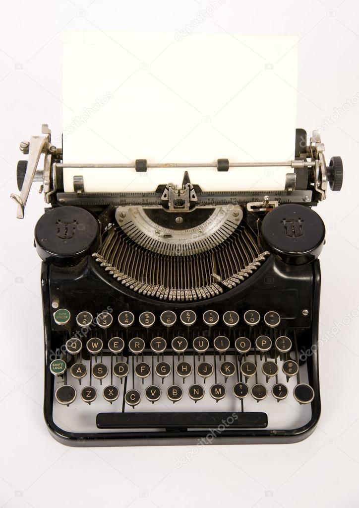 Vintage typewriter on a white background — Stock Photo #14216352