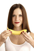 Banana Showing Manicured Beautiful Brunette Woman Holding Fruit Food — Stock Photo