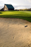 Sand Trap Player Hazard Fronts Barn on Rural County Golf Course — Stock Photo