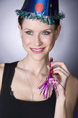 Party Goer Female Looks Happy Holding Party Noise Maker — Stock Photo
