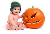 Baby Boy Infant Male Child with Carved Orange Halloween Pumpkin — Stock Photo