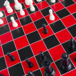 Chess Game Pieces Red Black Checkered Board — Stock Photo