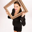 Woman Framed By Ornate Gold Frame Held Overhead — Stock Photo