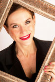 Pretty Smiling Woman Framed by Ornate Gold Frame — Stock Photo