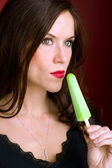 Attractive Woman Enjoys Green Frozen Ice Cream Treat — Stock Photo