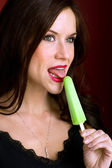Beautiful Brunette Woman Tasting Green Frozen Ice Cream Treat — Stock Photo