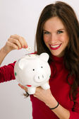 Woman Saves a Quarter Inserting it into Porcelain Piggy Bank Saving Money — Stock Photo