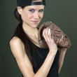 Stock Photo: Female Baseball Player Holds Ball in Leather Glove