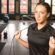 Boot Camp Woman Smiling While Doing Rope Work in Gym — Stock Photo #16586249