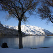 Winter Snow on the Peaceful Columbia River - Stock Photo