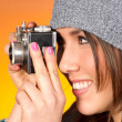 Hip Woman Snaps a Picture with Vintage Camera - 图库照片