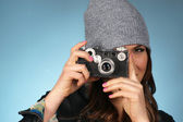 Hip Woman Snaps a Picture of Viewer with Vintage Camera — Stock Photo