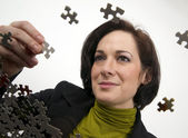 Woman Working a Jigsaw Puzzle — Stock Photo