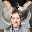 Attractive Woman Gets Spa Salon Shampoo and Conditioning - Stock Photo