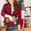 Stock Photo: WomWorks on Bench Repairing Dolly