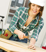 Woman Works on a Bench Building Something — Stock Photo