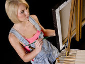 Happy Blond Woman Provides Finishing Touches to Painting on Ease — Stock Photo
