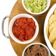 Food Appetizers Chips Salsa Refried Beans Guacamole Wood Cutting - Stock Photo
