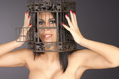 Beautiful Manicured Woman Holding Her Head Inside Metal Bird Cag — Stock Photo