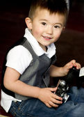 Happy Young Boy in Vest Plays Around With Vintage Camera — Stock Photo