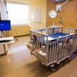 Foto Stock: Medical Inspection Light Shines Down Bed Childrens Hospital Room