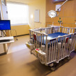 Stock Photo: Medical Inspection Light Shines Down Bed Childrens Hospital Room