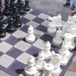 Man Moves Piece Playing Giant Chess Game Sidewalk Downtow — Stock Photo
