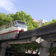 seattle monorail transit train travels over neighborhood retro style — Stock Photo