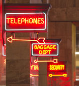 Red Neon Sign Indoor Depot Signage Arrow Points Baggage Telephone — Stock Photo