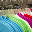 Stock Photo: Retail Store Clothing Rack Plastic Hangers Fashion Apparel Vibrant Color