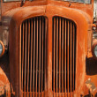 Stock Photo: Old Orange Vinatge Fire Truck Sits Rusting in Desert Country