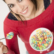Happy Attractive Woman Eats Bowl Colorful Breakfast Cereal — Stock Photo #33220361