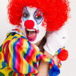 Colorful female clown actress speaking out — Stock Photo
