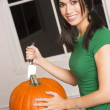 Woman preps Pumpkin for Halloween — Stock Photo