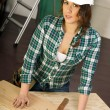 Woman Works on Construction Project Plywood Hardhat Tools Hammer — Stock Photo #33543789