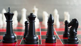 Red Black Chess Board Game Pieces King Queen Bishop Knight — Stock Photo