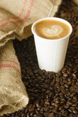 Cappuccino To Go Paper Cup Burlap Bag Roasted Coffee Beans — Stock Photo