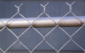 Backyard Re-Painted Metal Chain Link Fence Top Post Wire — Stock Photo